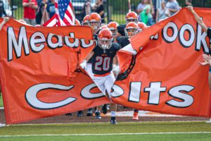 Football player tearing the banner